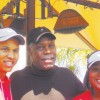 Junior golfers Dreydon Wooden (L) and Lolita Moore (R) with actor Danny Glover.