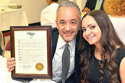 Johnny Bailey and daughter Alexandria accept Links Inc. honor for Bob Bailey.