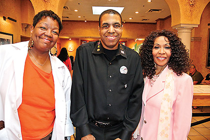 Ricky Parrish (center) celebtares his 20th year at the Olive Garden with Jackie Cahee and Krista Epps.